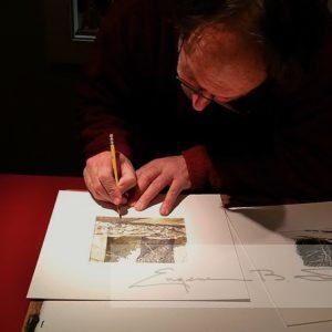 Signing an original watercolor