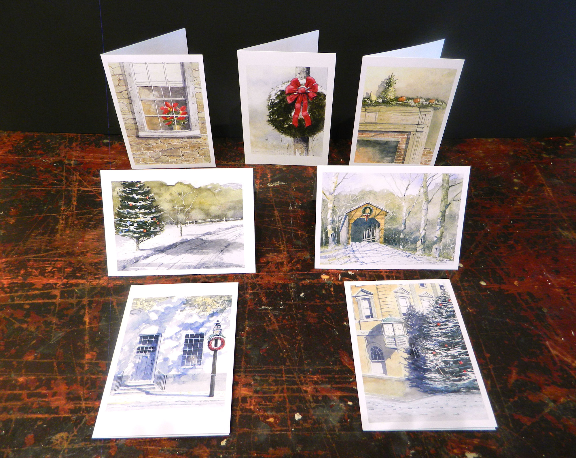 Notecards in this pack: Christmas Past | Old Town Christmas | Christmas Lane | Shenandoah Christmas | Christmas Window | Christmas Wreath | Christmas Glow | 7-pack w/envelopes $21